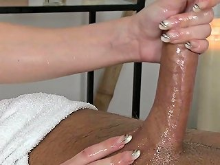 Massaging Babe Tugging Clients Cock