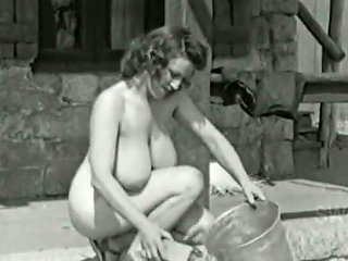 Absolutely Naked Bosomy Sex Pot Cleans Floor Outdoors