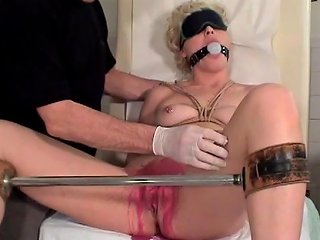 Bound And Gagged Hottie Gets Her Pussy Covered With Wax