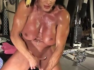 Muscled Girl Masturbating In The Gym Look Her Boobs Dancing