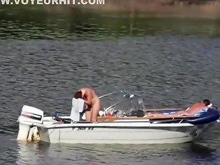 Nudist Couple Has Fun In The Middle Of A Beautiful Lake