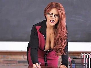 Curvy Teacher In Dark Lipstick Teases Her Cleavage