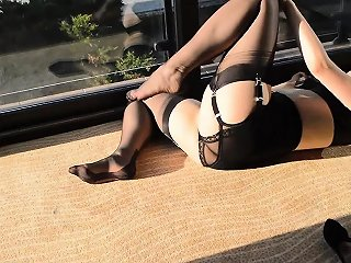 Teasing Tanned Brunette Taking Her Lace Lingerie Off Outdoor