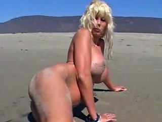 Sultry Big Boobed Lady Is Posing Nude On The Beach