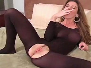 Sexy Babe In Bodystocking Posing And Showing Her Pussy