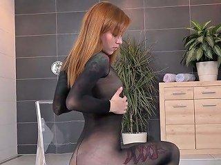 Hot Slut In Body Stockings Masturbates Pussy And Pisses In The Bowl