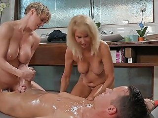 Stepmom And Friend Give Stepson A Relaxing Nuru Massage
