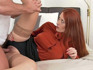 This Raunchy Redhead Is Having A Quickie With Her Clothes On
