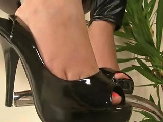 Leather Clad Italian Babe Showing Off Her Perfectly Pedicured Feet