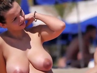 Pretty Girls With Big Boobs Tanning In The Sand